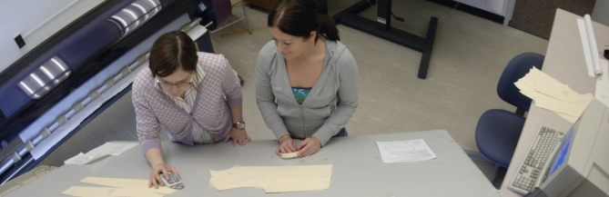 Two students working on a pattern